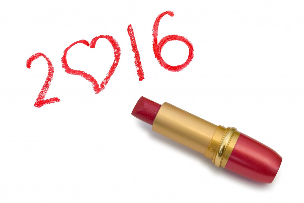 Lipstick and 2016 isolated on white background